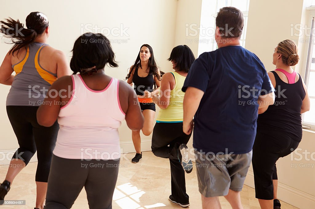 Fitness Instructor In Exercise Class For Overweight People stock photo