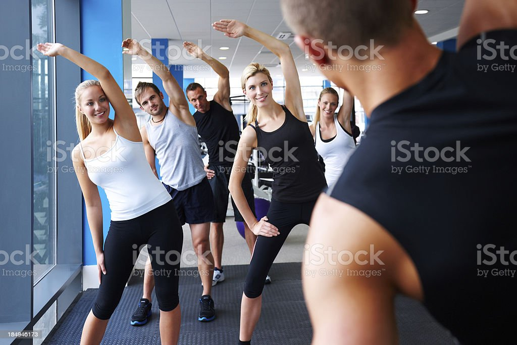 Fitness Instructor Leading Stretches royalty-free stock photo