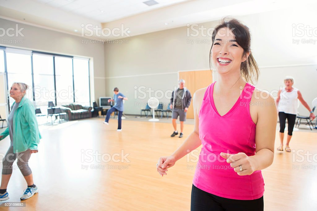 Fitness instructor leads dance class stock photo