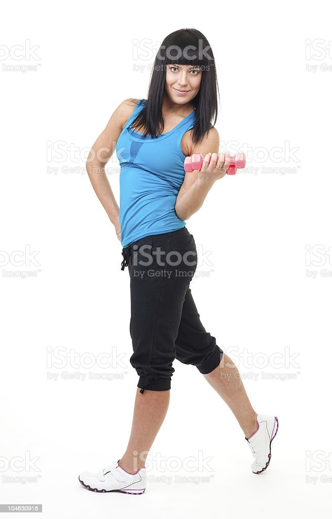 Fitness instructor stand with dumbbells royalty-free stock photo