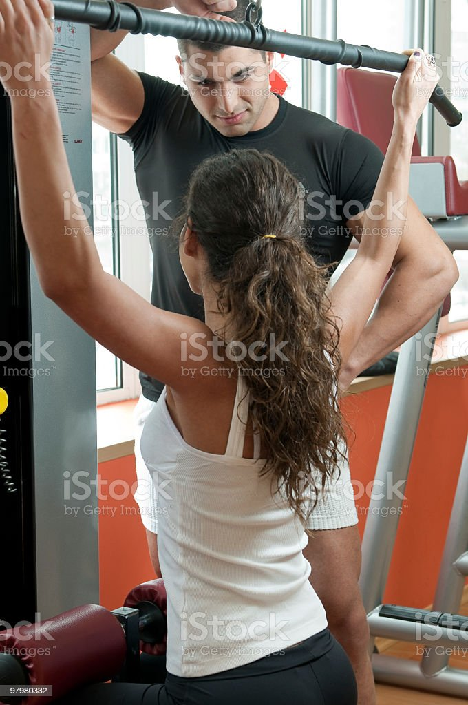 fitness instructor trains the young woman royalty-free stock photo