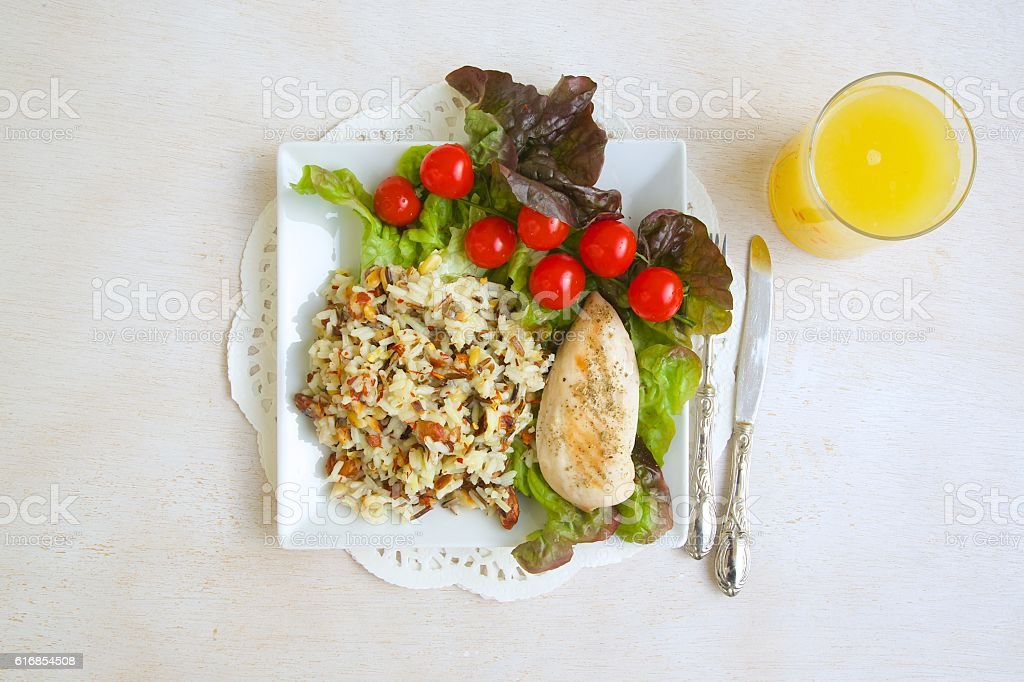 Fitness lunch with a glass of fresh lemon juice stock photo