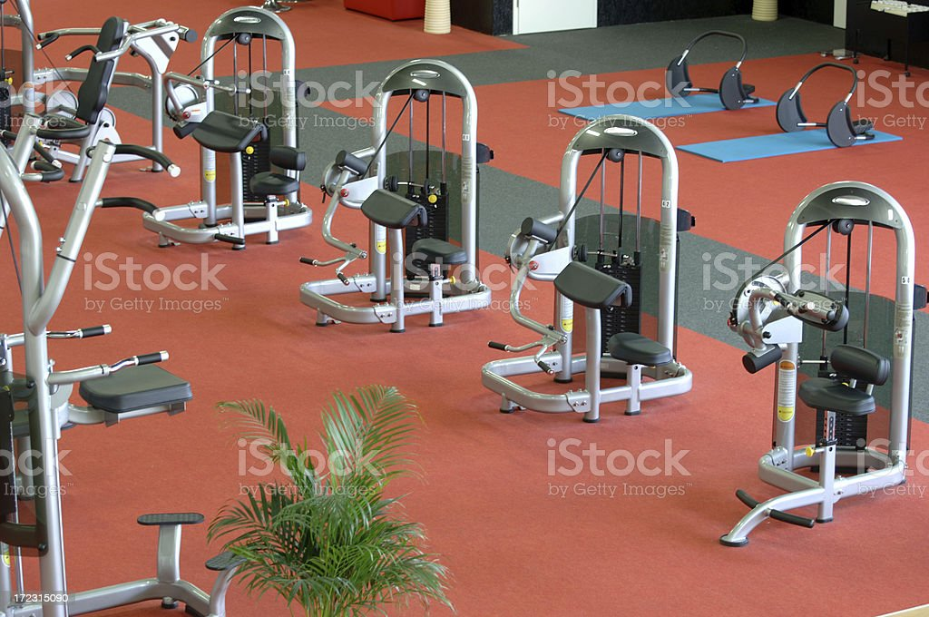 Fitness machines in a gym royalty-free stock photo