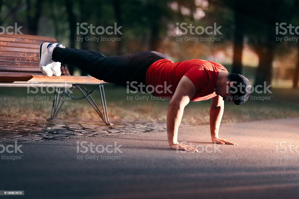 Fitness Man doing a Bench Press Up Outside stock photo