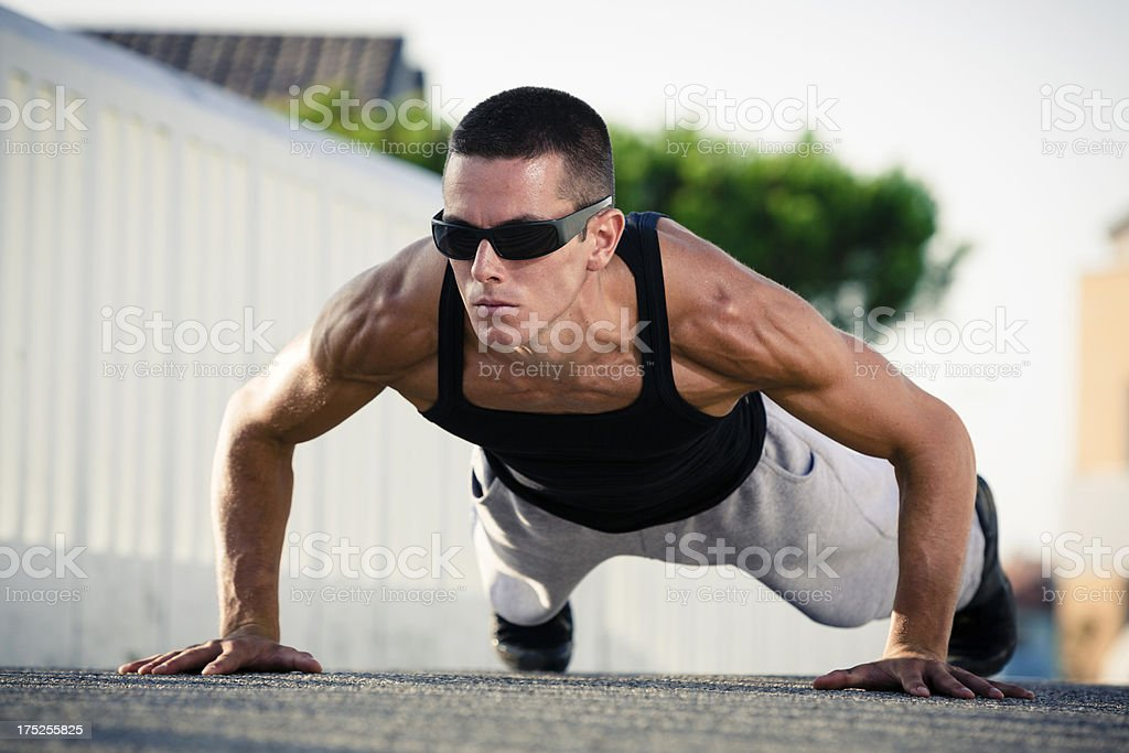Fitness man exercising push ups outdoor royalty-free stock photo