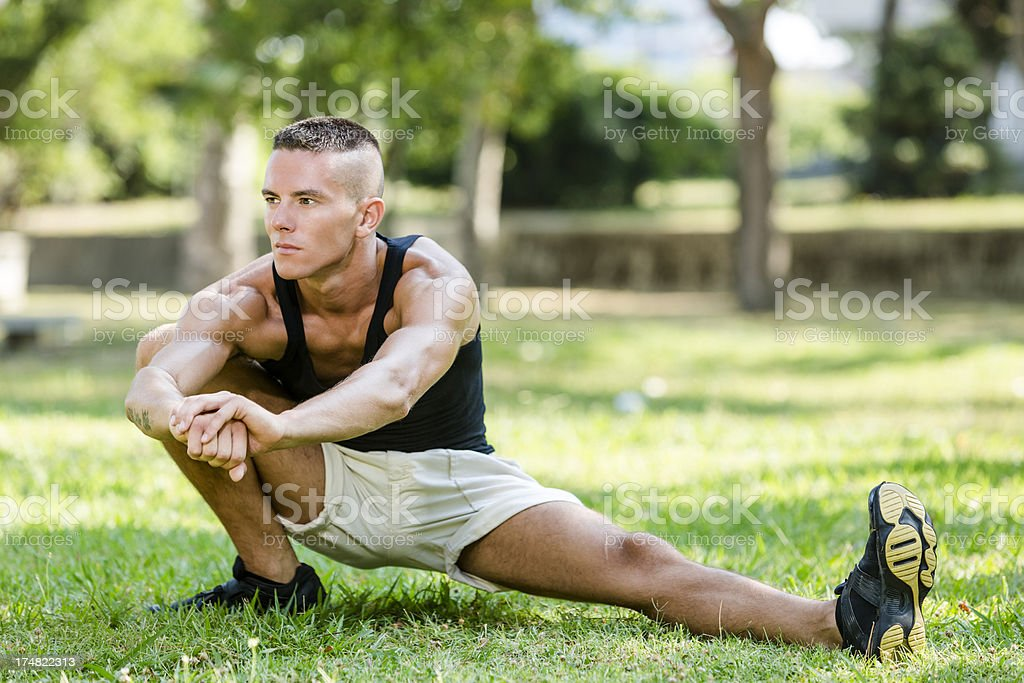 Fitness man exercising stretching royalty-free stock photo
