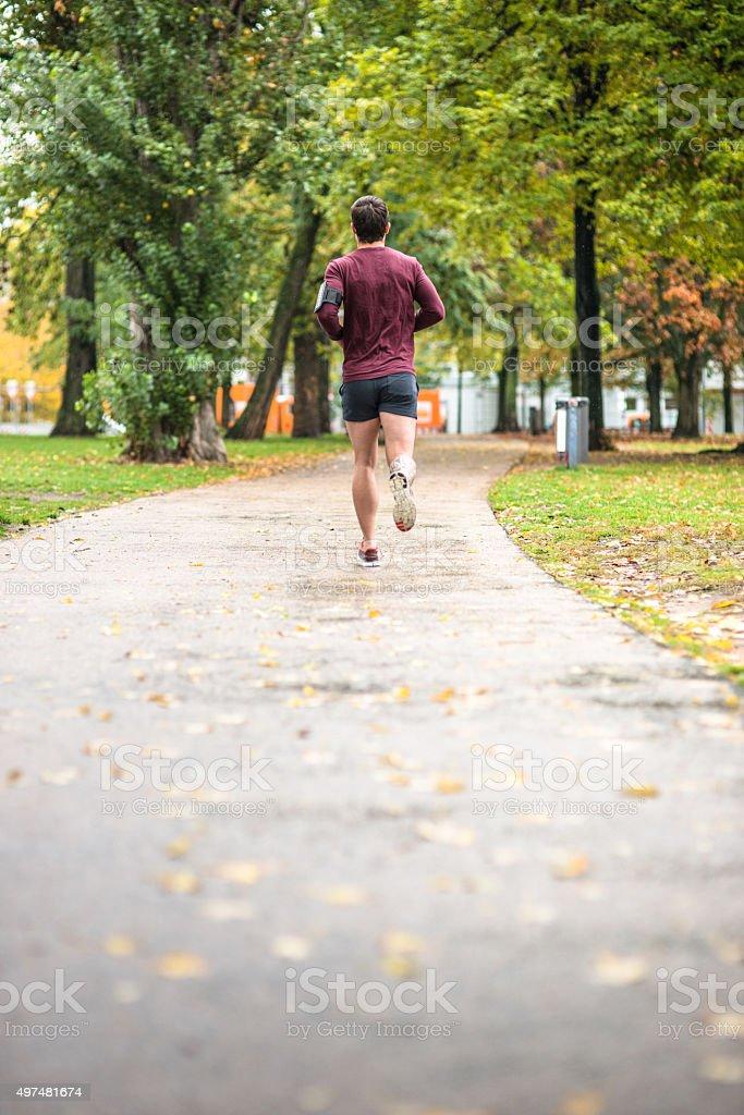 Fitness man running in Berlin rear view stock photo