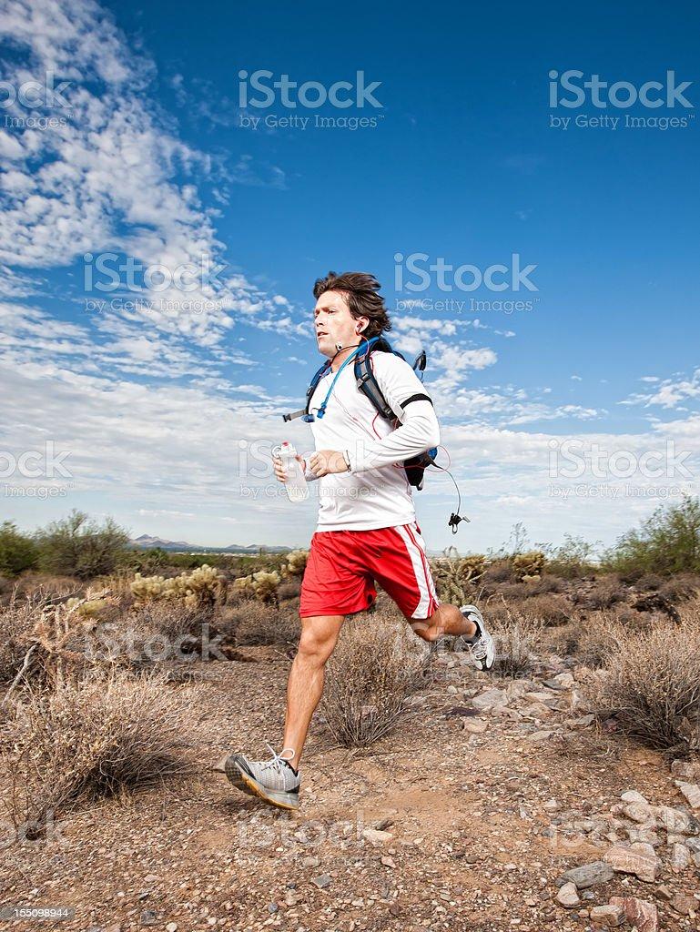 Fitness Man Running in Desert royalty-free stock photo