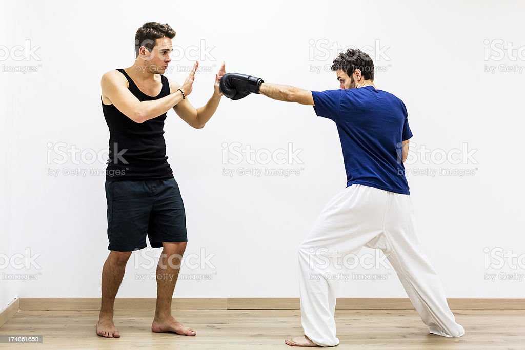 Fitness - Man with instructor training boxing royalty-free stock photo