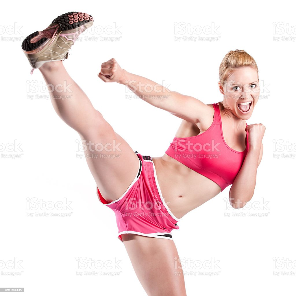 Fitness Model Doing High Kick stock photo