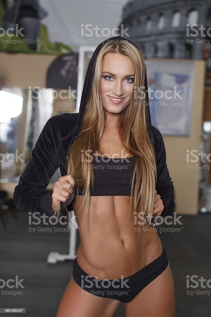 Fitness model posing in gym royalty-free stock photo
