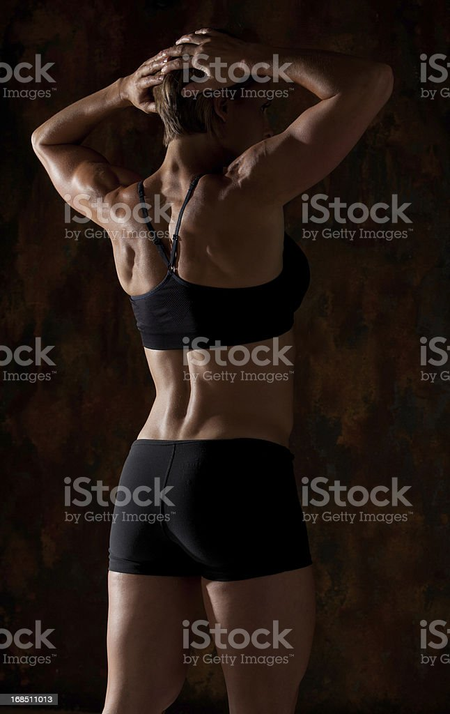 Fitness Model showing off her back stock photo