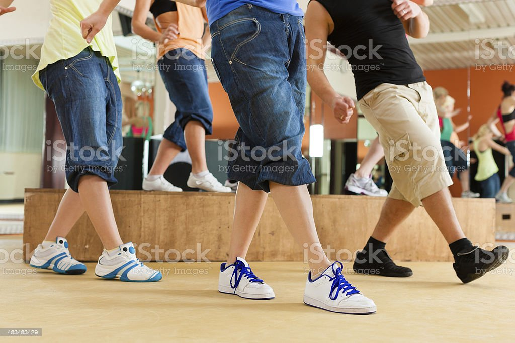 Fitness or Jazzdance - young people dancing in studio stock photo