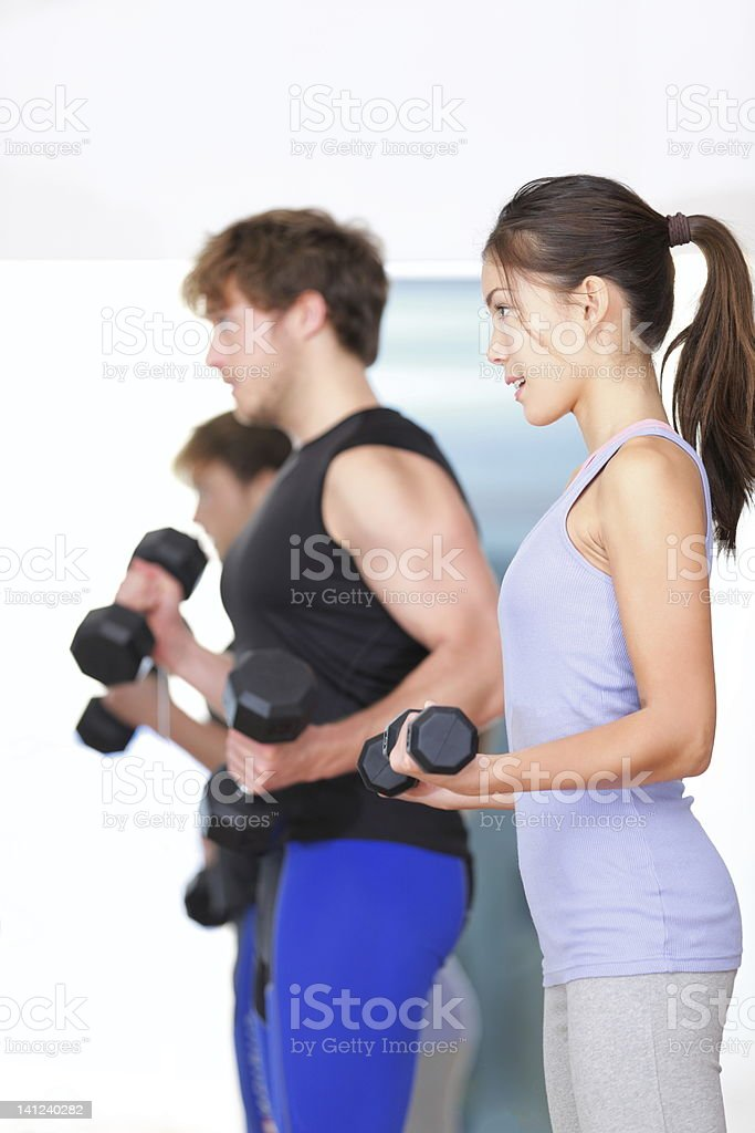 Fitness people in gym royalty-free stock photo