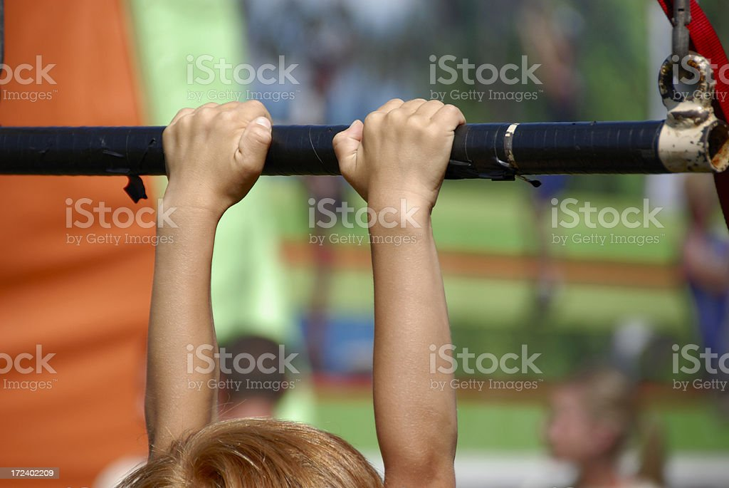 Fitness Play: Grasping Hands of an Exercising Child royalty-free stock photo