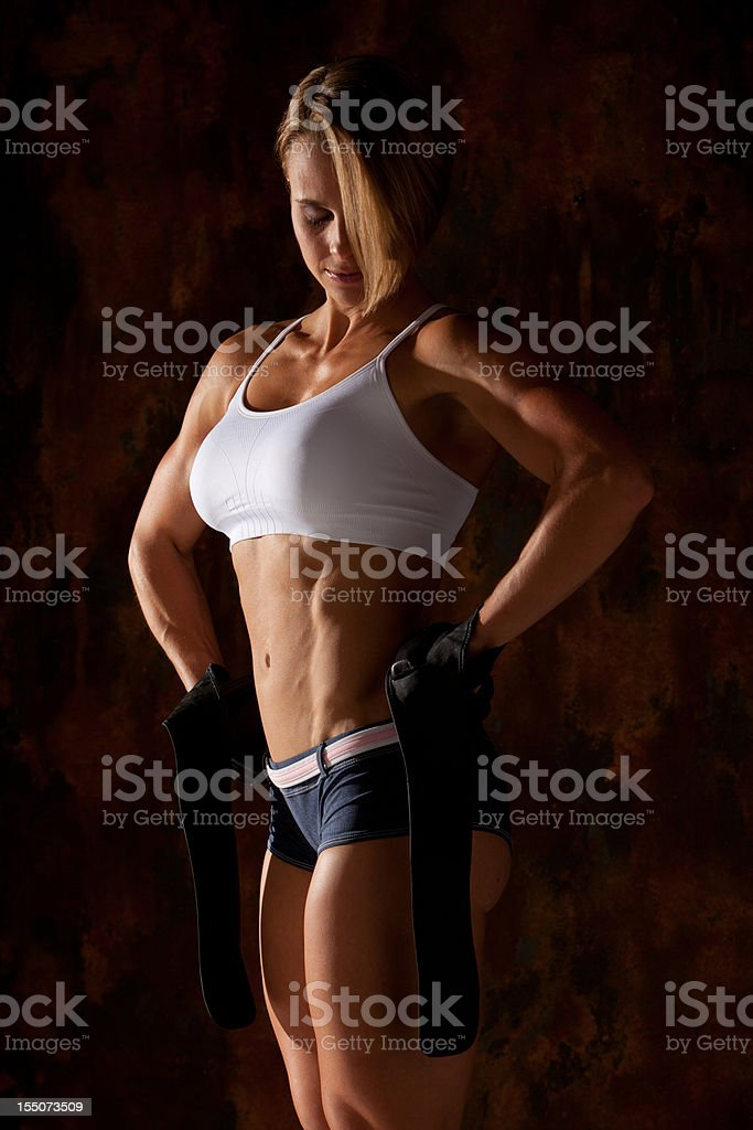 Fitness Professional with weightlifting gloves and wraps royalty-free stock photo