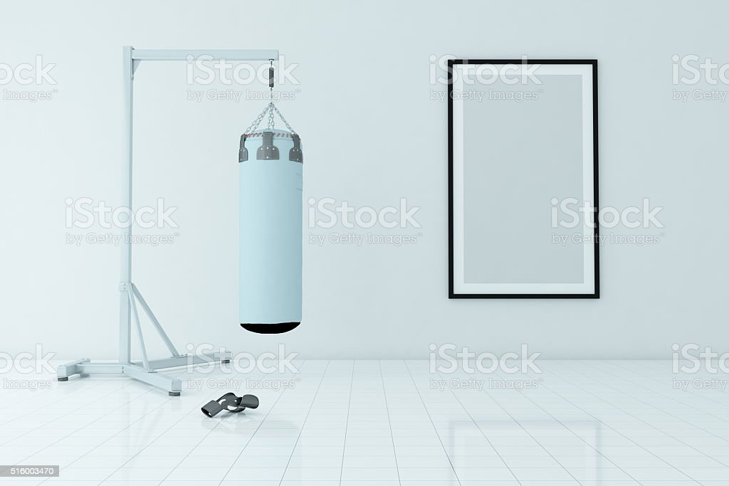 Fitness Room Interior With Punch Bag and Blank Frame stock photo
