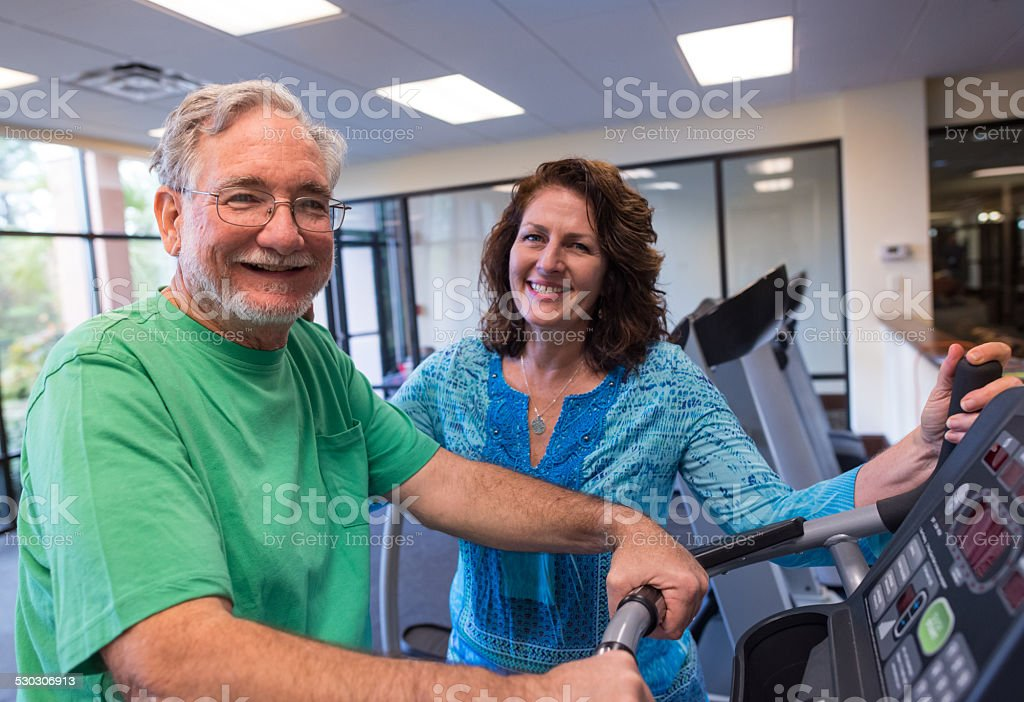 Fitness room (real people) stock photo