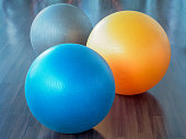 Fitness rubber balls on parquet floor