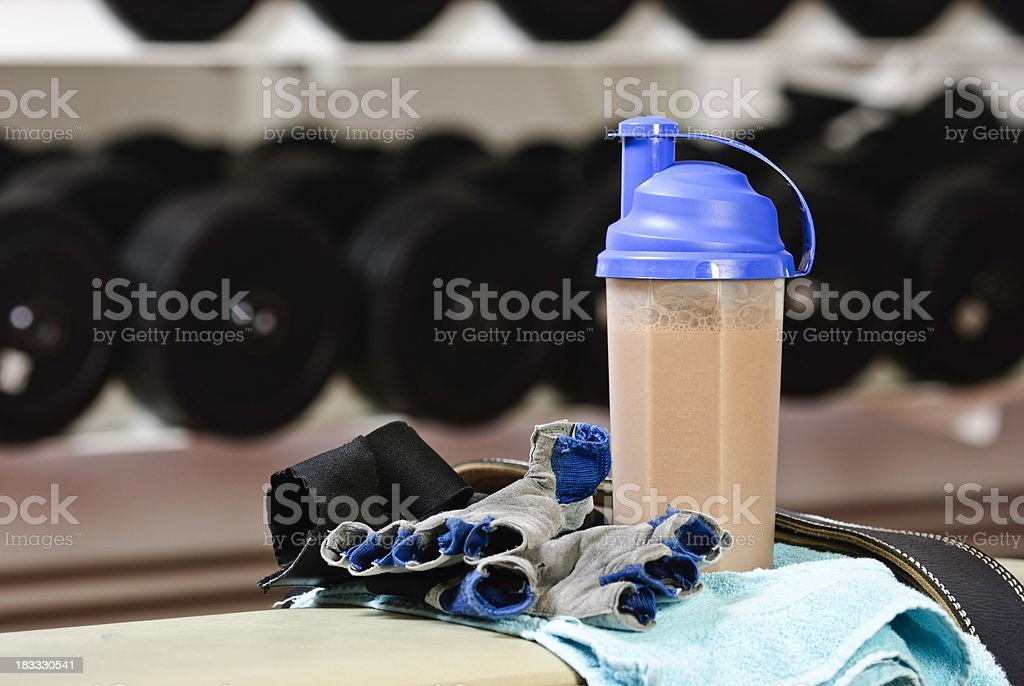 Fitness shake and gear in gym stock photo