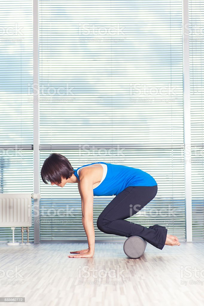 fitness, sport, training and lifestyle concept - woman doing pilates stock photo
