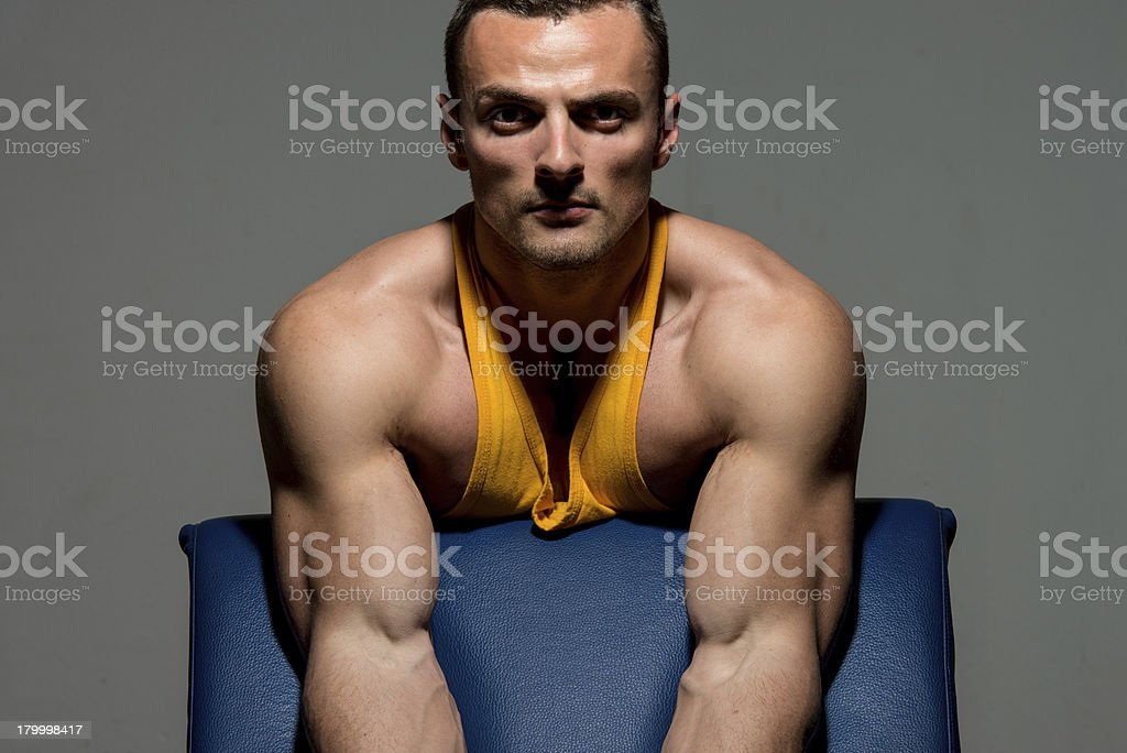 fitness trainer doing heavy weight exercise for biceps royalty-free stock photo