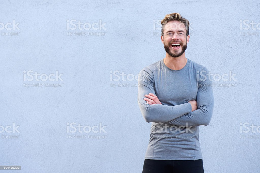 Fitness trainer laughing with arms crossed stock photo