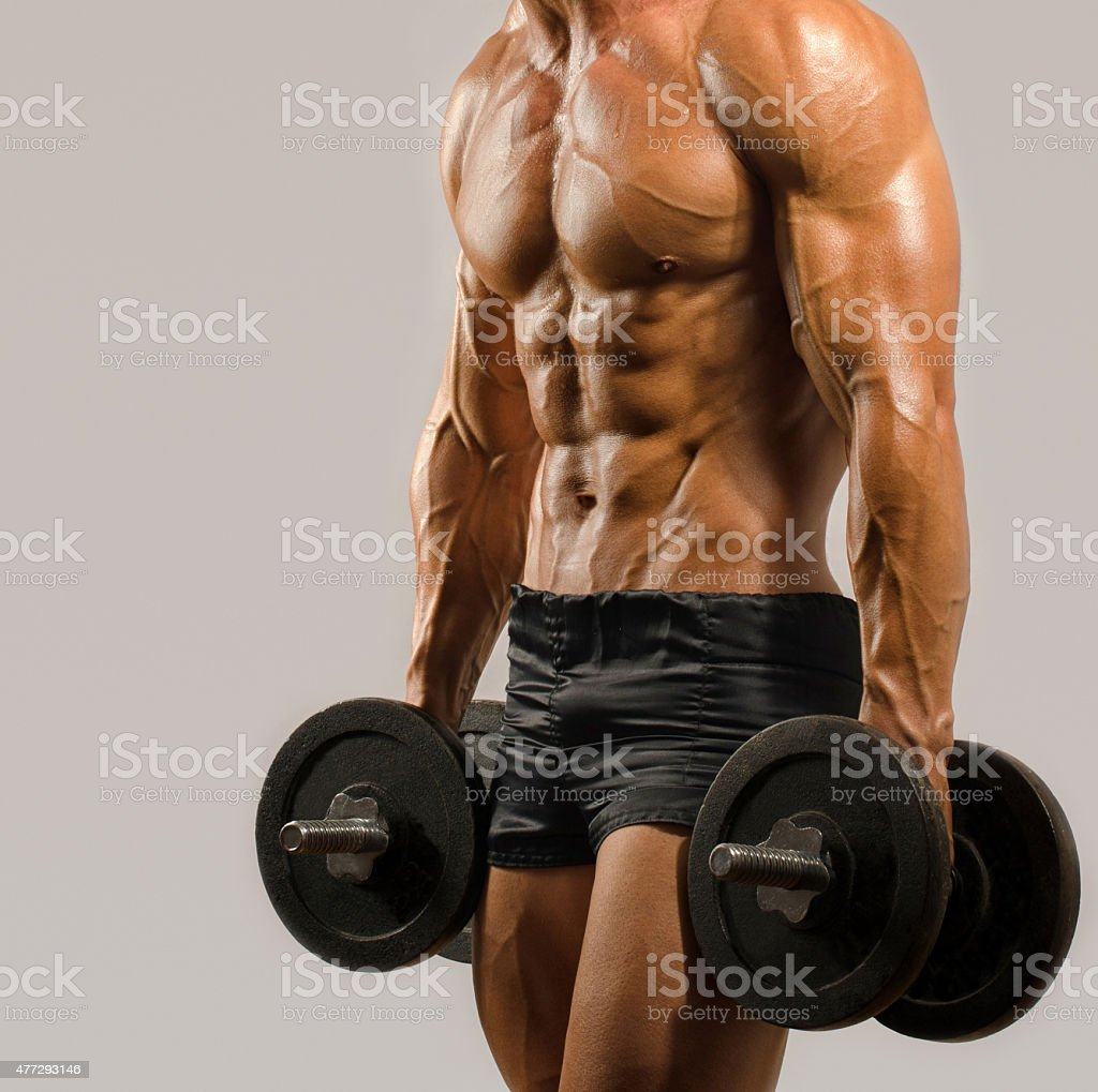 Fitness trainer training with heavy dumbbells, flexing biceps, bodybuilder stock photo