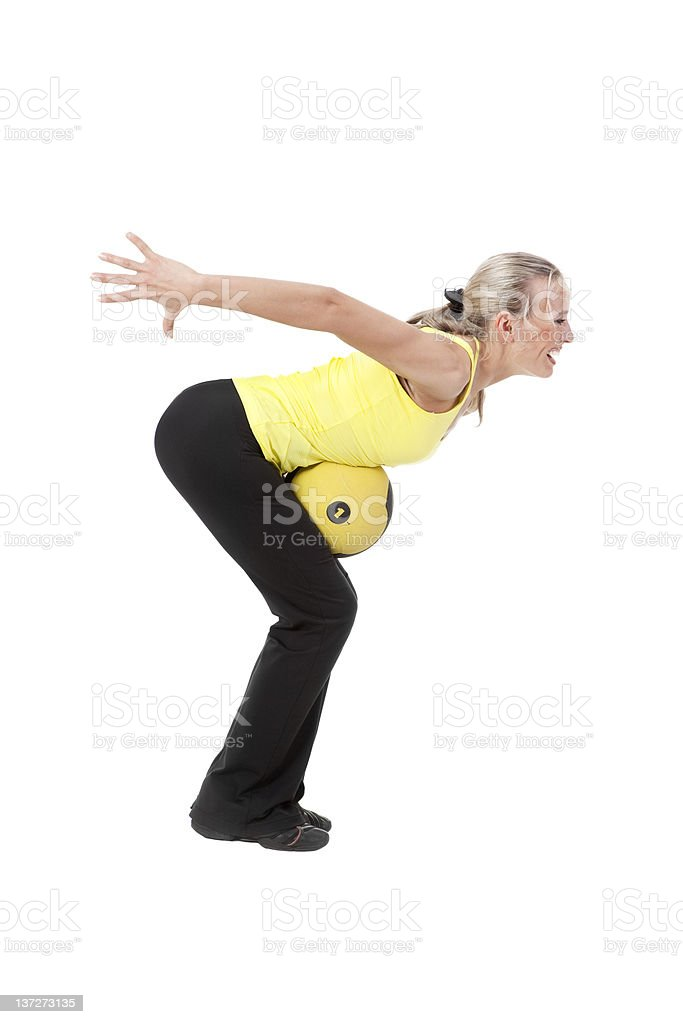Fitness with ball: young woman doing exercises. royalty-free stock photo