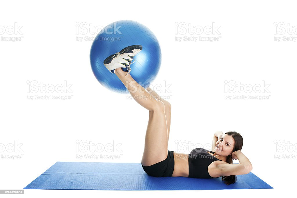 Fitness woman doing crunches on gym mat royalty-free stock photo