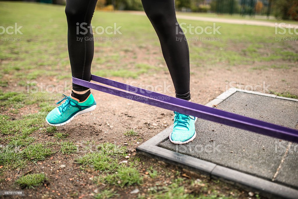 fitness woman doing exercise with rubber band stock photo