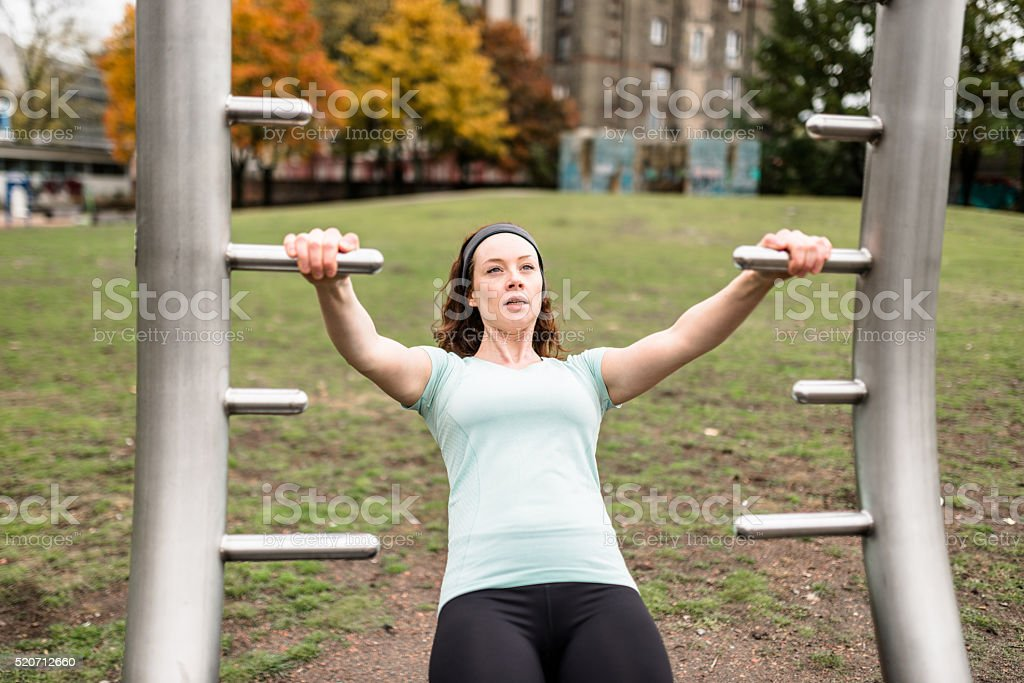 Fitness woman doing pectoral traction stock photo
