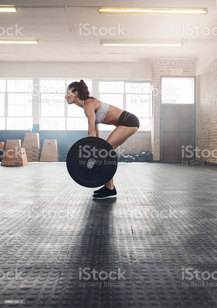 Fitness woman doing weightlifting exercise stock photo
