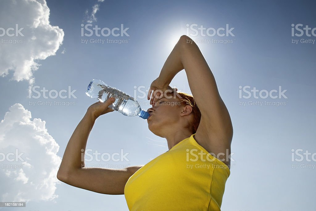 A fitness woman drinking water royalty-free stock photo
