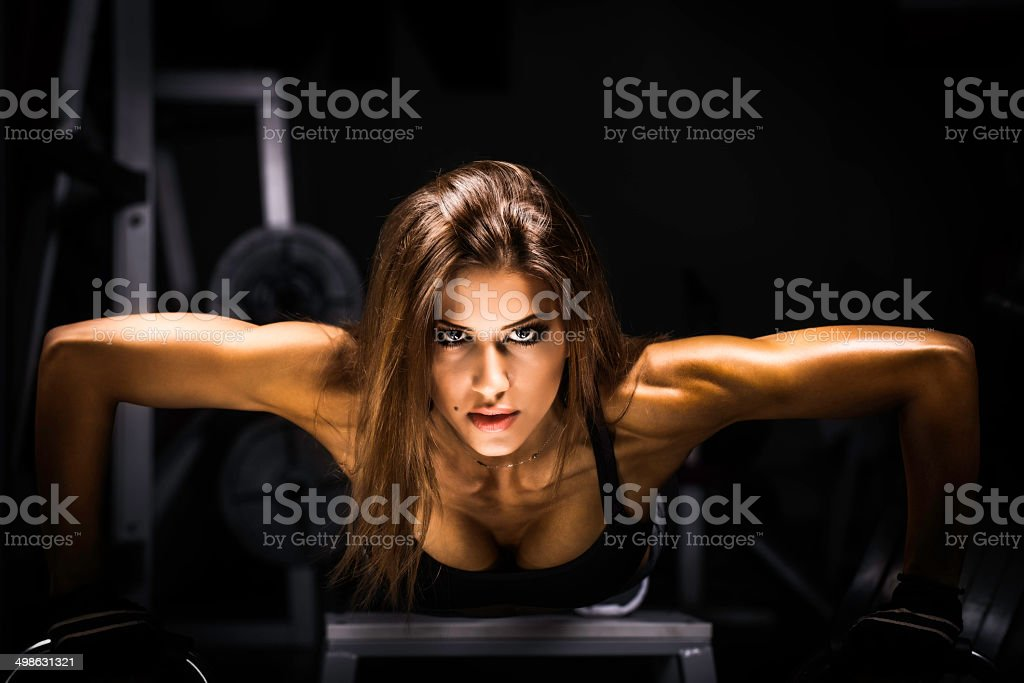 fitness woman exercising push ups stock photo