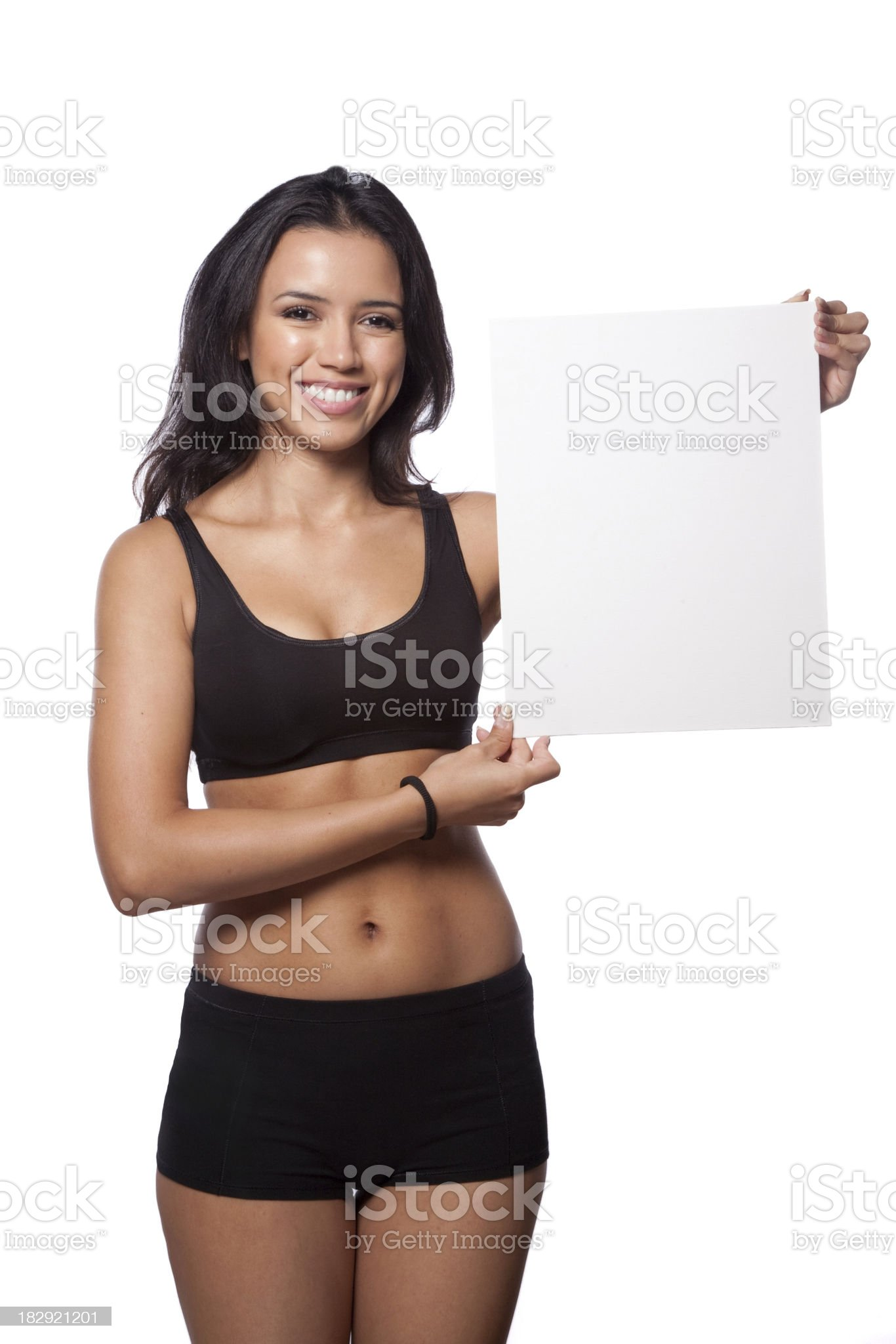 Fitness woman holding a blank sign royalty-free stock photo