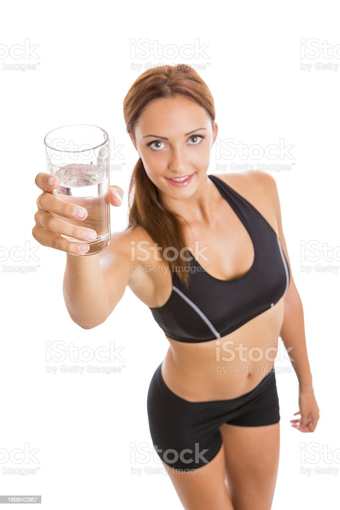 Fitness woman holding a glass of water royalty-free stock photo
