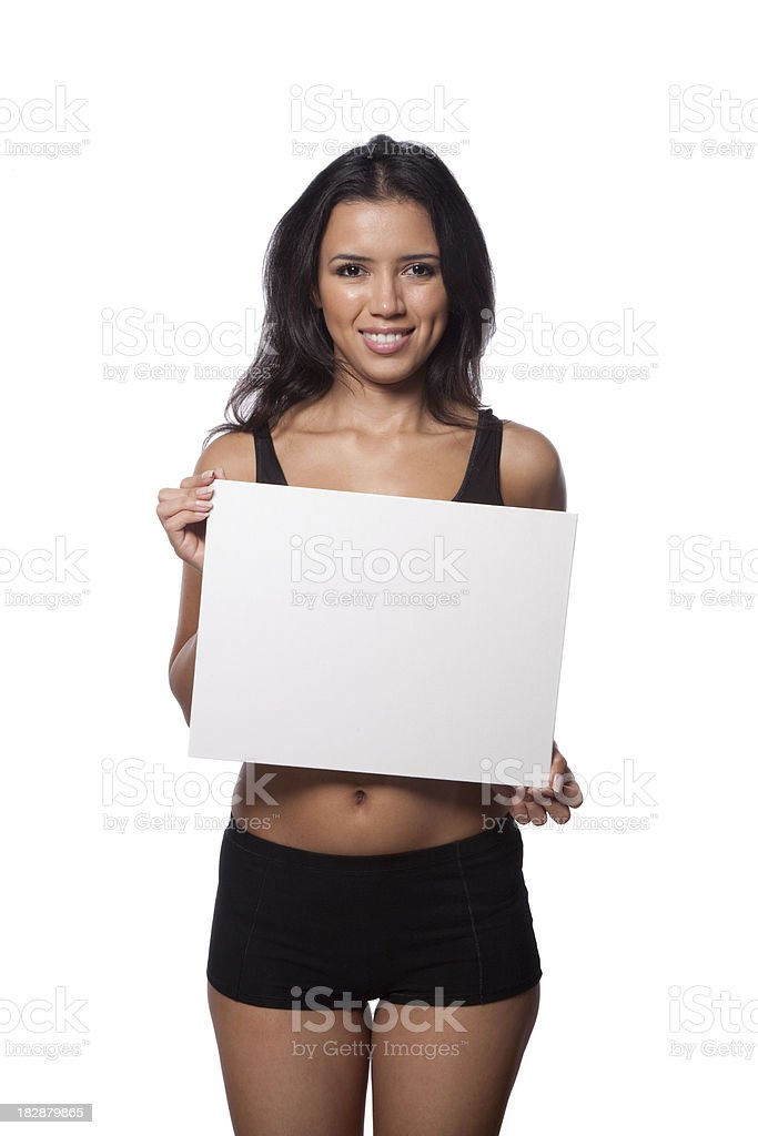 Fitness woman holding a horizontal empty sign royalty-free stock photo