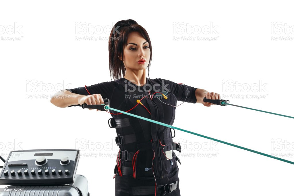EMS fitness woman. Horizontal thrust exercise with training cable stock photo