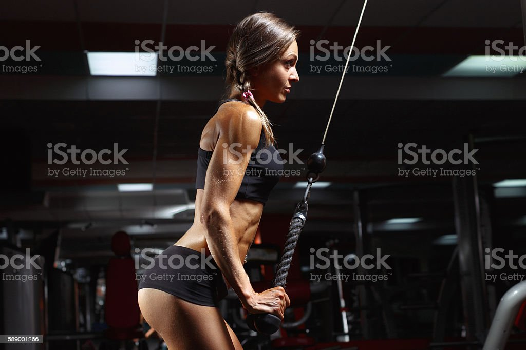 Fitness woman in the gym. stock photo