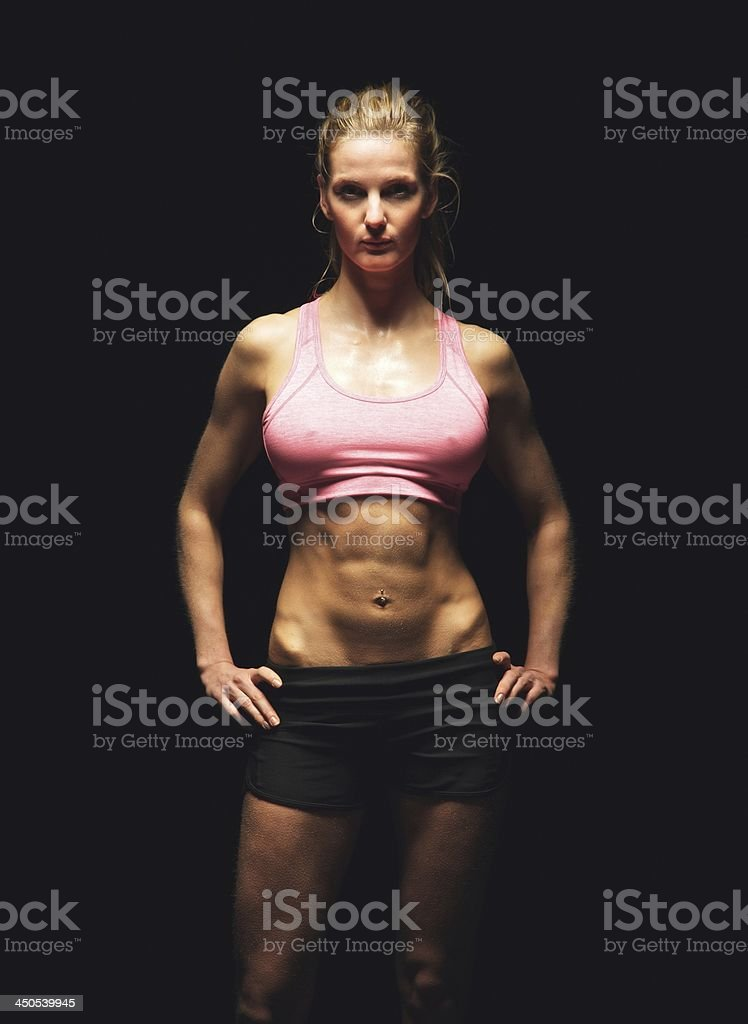 Fitness Woman Isolated on Black Background Looking at You stock photo