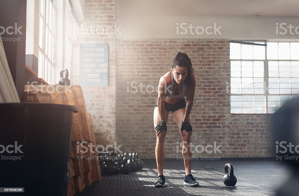 Fitness woman looking tired after intense workout stock photo