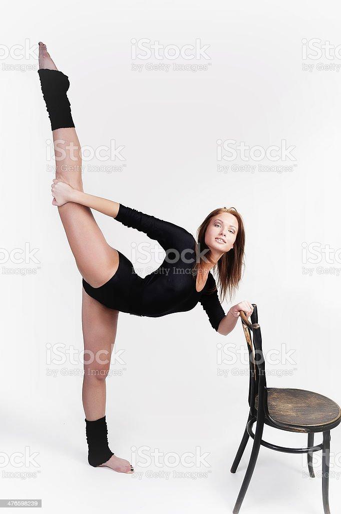 fitness woman making balance exercise royalty-free stock photo