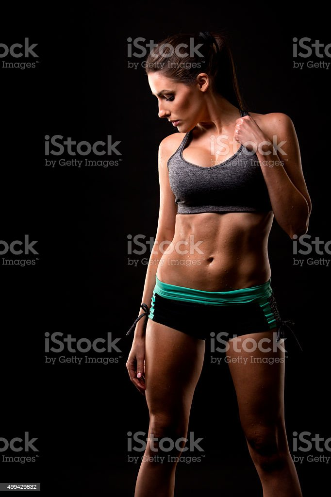 fitness woman on black background stock photo