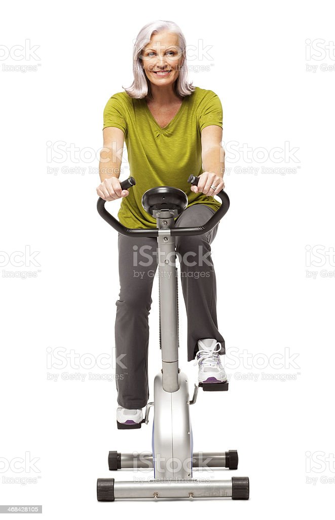 Fitness Woman on Exercise Bike - Isolated royalty-free stock photo