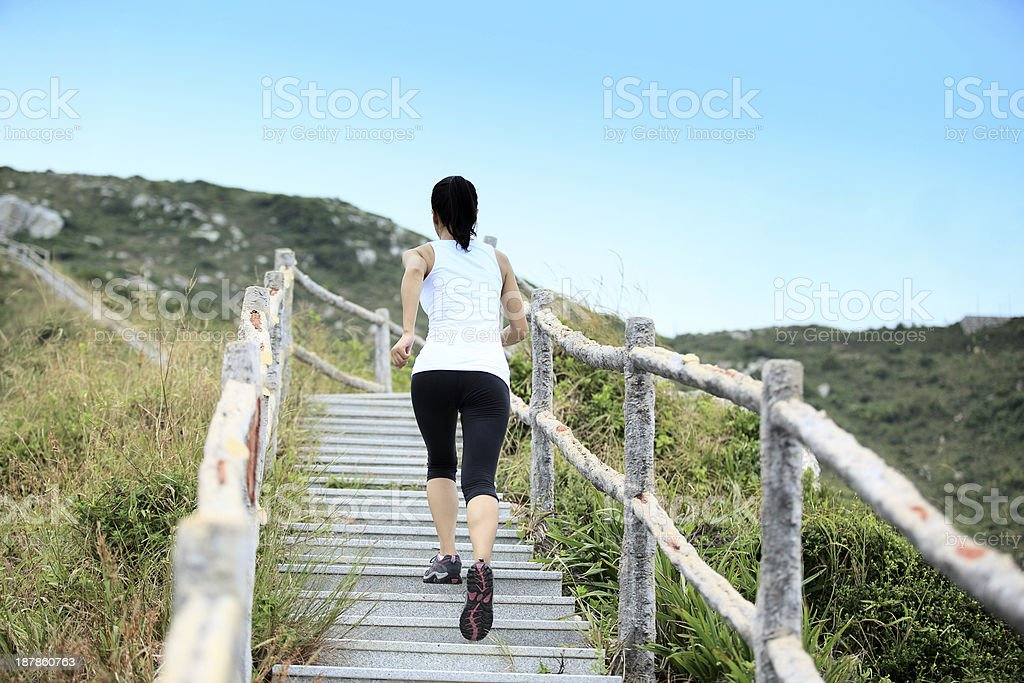 fitness woman runner mountain stairs royalty-free stock photo