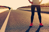 fitness  woman runner standing with her hands on hips