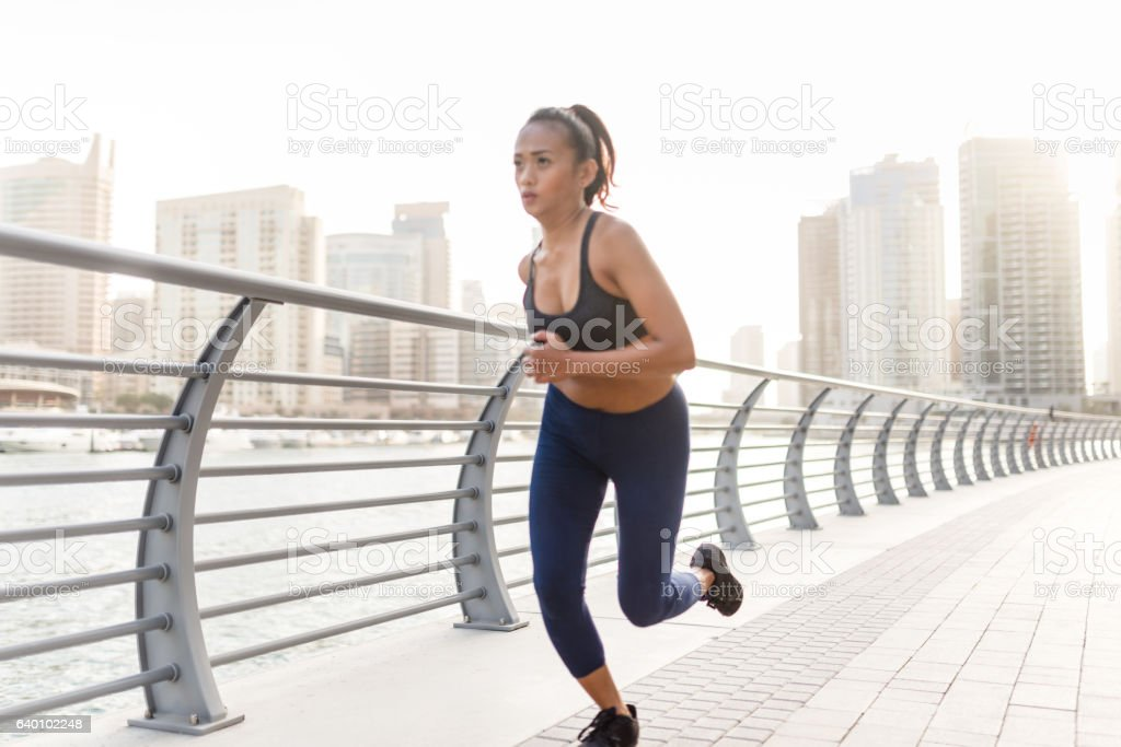 Fitness Woman running in Dubai Marina stock photo