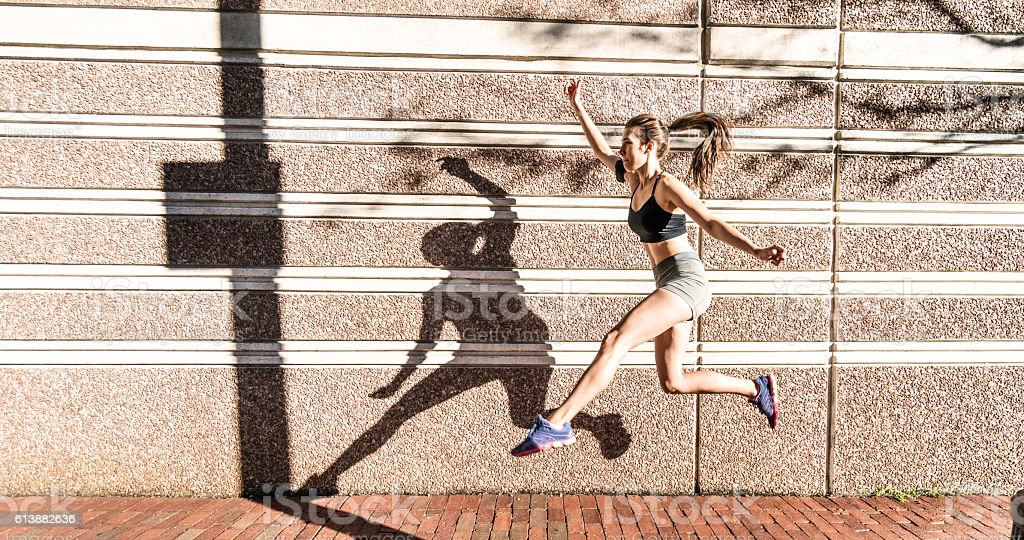Fitness Woman running on the city stock photo