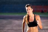 Fitness woman running on the stadium